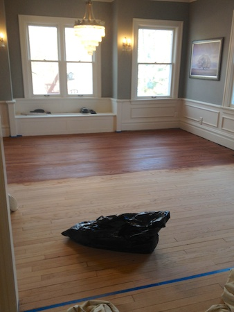 Staining the dining room floor.