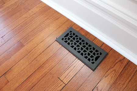 I just love how the wood floors make other details (like these vents) pop!