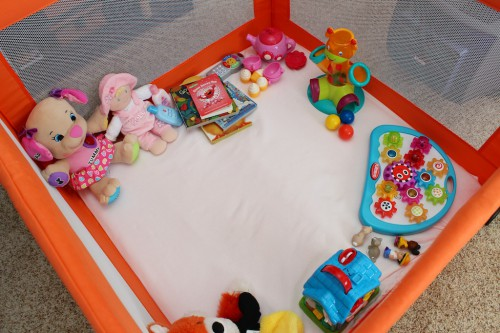 Freshly rotated toys in Haley's playpen.
