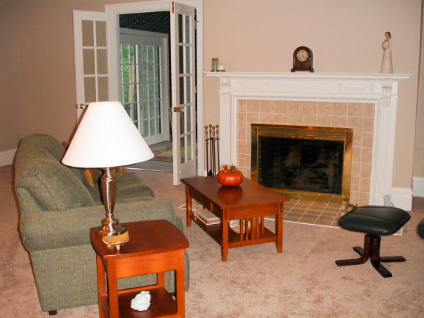 Our living room the week after we moved in (Sherwin Williams Sand Dune paint color).