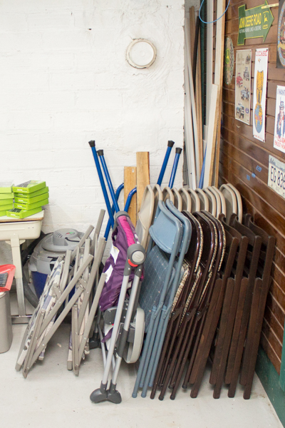 Folding chairs temporarily stored in the workshop.